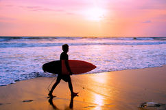 Surfer at Balinese beach, Indonesia Royalty Free Stock Photo