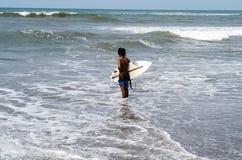 Surfer at Batu Balong / Old Man`s in Canggu Stock Photography