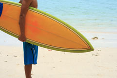 Surfer on beach Royalty Free Stock Image