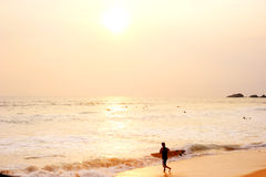 Surfer on the beach Royalty Free Stock Photo
