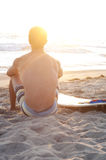 Surfer at the beach Stock Image