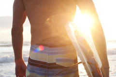 Surfer on the beach. Holding surfboard Royalty Free Stock Photo