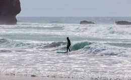 Surfer on the beach of Arrifana in Portugal. Alentejo Royalty Free Stock Photography