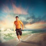 Surfer on the beach Stock Photos