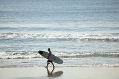 A surfer on the beach in Durban Stock Photo