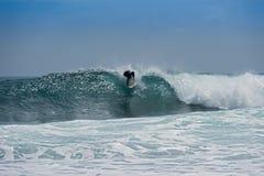 Surfer on the beach near Puerto Viejo, Costa Rica Stock Photography