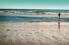 Surfer on beach. Surfer on the ocean beach at sunset in conil, spain Stock Images