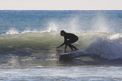 Surfer on the beach of Recco in Genoa Stock Photography