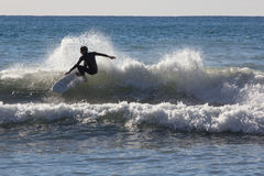 Surfer on the beach of Recco in Genoa Stock Image