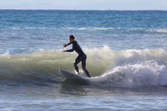 Surfer on the beach of Recco in Genoa Royalty Free Stock Photo