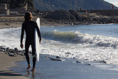 Surfer on the beach of Recco in Genoa Royalty Free Stock Photography