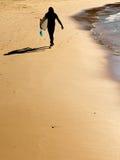 Surfer on the beach, silhouette Stock Photos