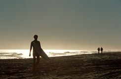 A surfer on a beach in South Africa. Royalty Free Stock Image