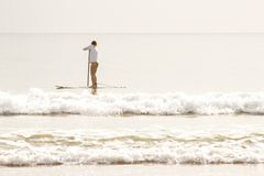 Surfer on the beach. royalty free stock image