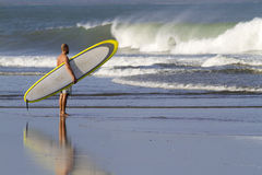 Surfer at the beach Stock Photography