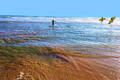 Surfer on the beach. Surfers on the ocean beach at sunset in conil, spain Royalty Free Stock Photo
