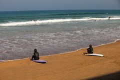 Surfer beach of Zarauz with surfers waiting for a wave. stock image
