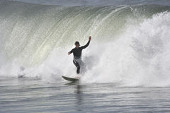 Surfer with a big wave. In the back Royalty Free Stock Photos