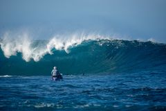 Surfer in the big wave stock photos