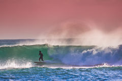 Surfer on Blue Ocean Wave in Bali Royalty Free Stock Image