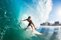 Surfer. On Blue Ocean Wave Getting Barreled royalty free stock photography