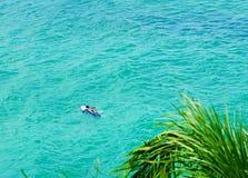 Surfer on Blue Ocean Wave Stock Photo