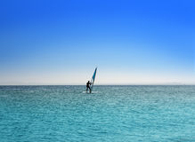 Surfer on blue sea under sky Stock Images