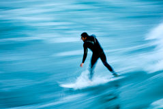 Surfer Blur 2. Long exposure showing the speed and intensity of the surf and the surfer. Photo taken along the central coast of California royalty free stock photo