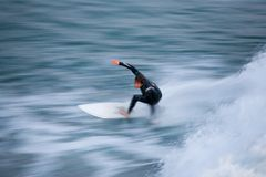 Surfer Blur 3. Motion blur of a speedy, fit surfer stock photos