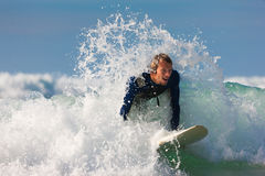 Surfer and board in sea with waves Royalty Free Stock Photo