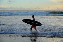 Surfer with board Stock Photography