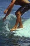 Surfer an Bord Stockbild