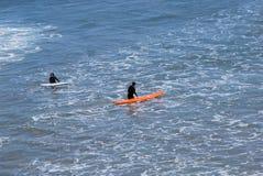 Surfer an Bord Stockfoto