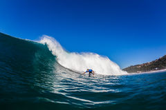 Surfer Wave Bottom Turn. Surfer rider committed bottom turn on large wave.Water photography of surfing action Royalty Free Stock Image