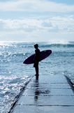 Surfer boy. Young surfer looking at the waves Stock Photography