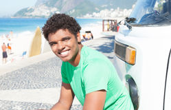 Surfer boy at beach at Rio de Janeiro. With beach and ocean in the background Royalty Free Stock Photos