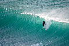 Surfer on breaking wave Cape town Royalty Free Stock Images