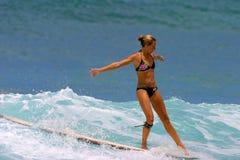 Surfer Brooke Rudow Surfing in Hawaii. Pro Surfer, Brooke Rudow, surfing on a longboard in Waikiki on the island of Oahu, Hawaii Royalty Free Stock Photos