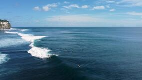 Surfer catch the wave aerial footage