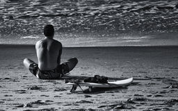 The Surfer. Caucasian male stretching before surfing Stock Photos