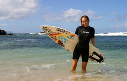 Surfer Cecilia Enriquez with Surfboard. Professional surfer girl, Cecilia Enriquez, stands on the beach with her surfboard in Hawaii Stock Images