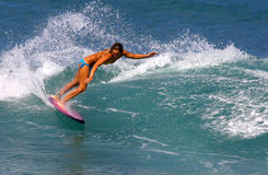 Surfer Cecilia Enriquez Surfing in Hawaii. Professional Surfer, Cecilia Enriquez surfing at Rocky Point on the North Shore of Oahu, Hawaii Royalty Free Stock Photos