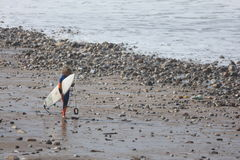 Surfer child. A little  child whit a surfboard in Peniche - Portugal Stock Photography