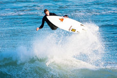 Surfer Chris Sanders Surfing at Steamer Lane California. Surfer Chris Sanders Catching Air while Surfing at Steamer Lane surf break in Santa Cruz, California Stock Image