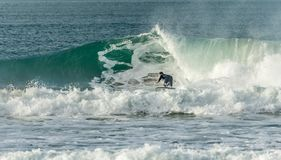 Surfer closing in on barrel, Fistral, Newquay, Cornwall royalty free stock image