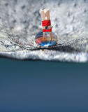 Surfer clothespin girl in red bikini on a wave. Royalty Free Stock Images