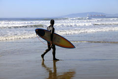 Surfer on a coastline Royalty Free Stock Image