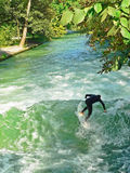 Surfer on a cold creek, germany Stock Photos