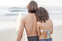 Surfer couple at beach Stock Photo