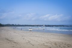 Couple carrying surboards kuta beach bali Royalty Free Stock Photo